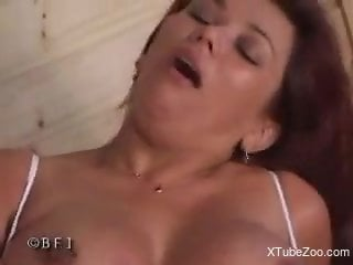 Busty mature works the dog cock like a professional