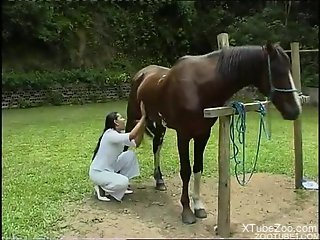 Horse fucks tight woman in the pussy while she's screaming hard