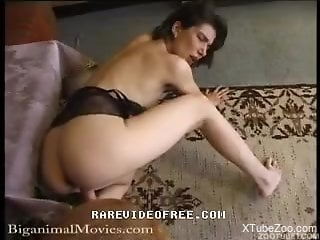 Naked slut loves the taste of dog cock and the soft feel it provides