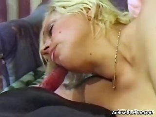 Milf licks and sucks whole dog penis in extra sloppy modes