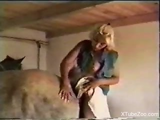 Blonde uses cow to fulfill dominant sexual desires