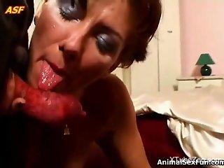 Redhead filmed sucking a stiff dog cock in extra sloppy modes