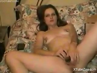 Kinky zoophile woman is naked and playing with her body