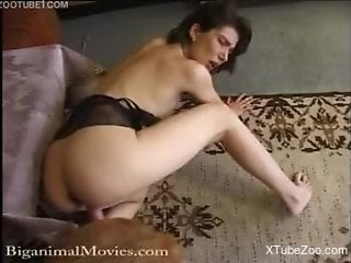 Brunette worships her dog's beautiful cock on cam
