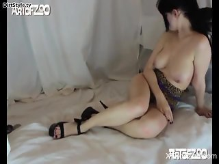 Masked brunette enjoying hard sex with a sexy dog