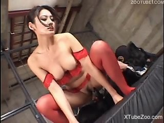 Asian beauty in red riding a dog's cock after a HJ