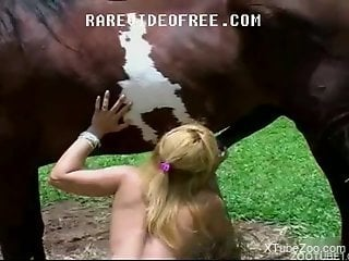 Blond-haired zoophile babe gets pounded by a stallion
