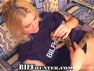 Blond-haired babe shoves a snake in her sexy slit