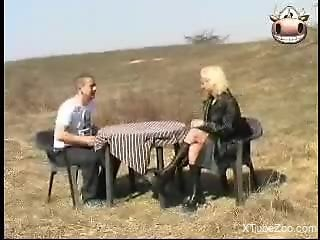 Outdoor fucking scene featuring a blond-haired zoo slut